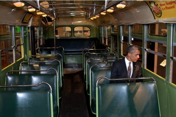 Obama sits on the Rosa Parks bus
