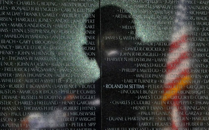 US President Barack Obama's Shadow Is Reflected On The Vietnam Veterans Memorial Wall