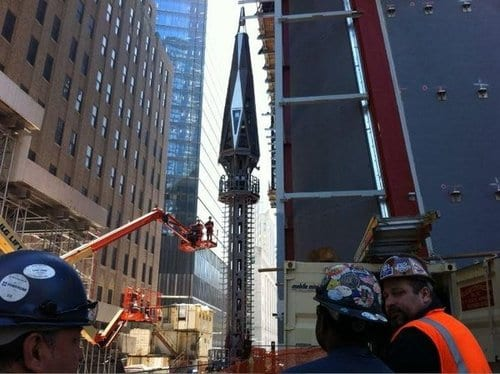 Spire Lifted To Roof Of One World Trade Center