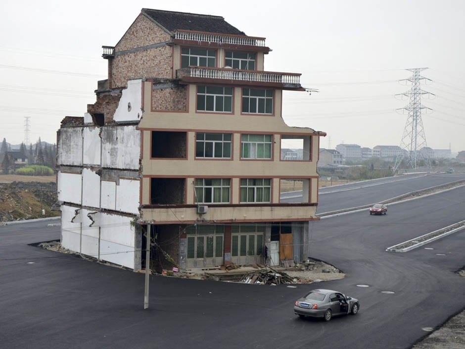 In One Chinese Province, The Government Literally Paves A Highway Around Homeowners Who Refuse To Move