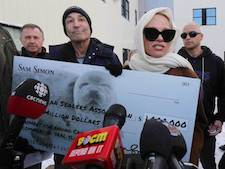 Pamela Anderson Simpsons co creator offer Newfoundland workers 1M novelty cheque to quit seal hunt 1