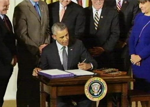 Obama signs trade worker assistance bills into law