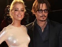 Johnny Depp's Wife Amber Heard Charged for Smuggling Dogs