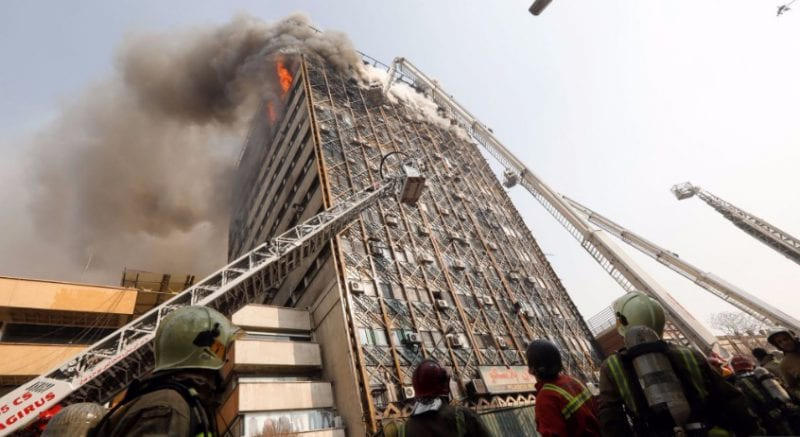 Burning TehranHigh Rise Collapses Kills 50 Firefighters