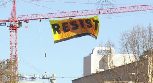 GreenpeaceProtesters Hanging From Crane In D.C.